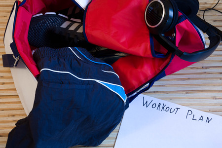 Collection of fitness accessories, gym bag, sneakers for Jogging, workouts, gym concept. Sport background. The view from the top. workout plan, layout, place for text