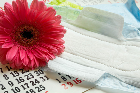 sanitary towel: Sanitary pads, calendar, towel and pink Gerber on light background