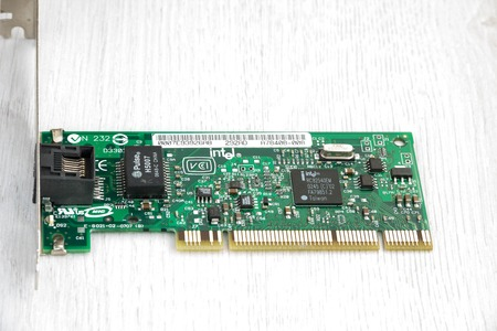 pci card: network card computer on wooden background