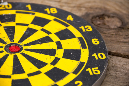 background texture metaphor: Darts dartboards, on a brown wooden Board. Table for the game of Darts. the success failure of the business concept. Closeup. place for text