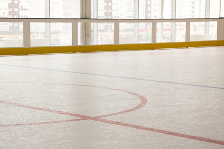 face off: red line on hockey rink. Face off circle. modern empty rink. Front view from ice Stock Photo