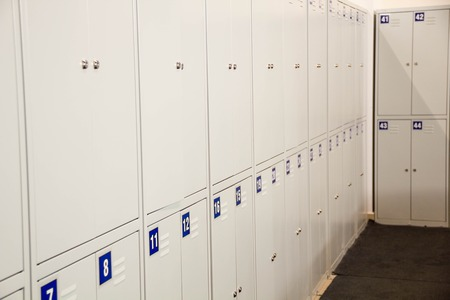 locker room: Student Gym Lockers University School Campus Hallway Storage Locker College. Locker Room. Lockers cabinets in a locker room at school or museum or station. Interior is modern locker rooms in Gym