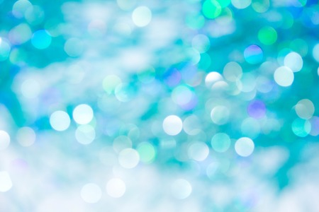 universal love: Lights on blue background. holiday bokeh. Abstract. Christmas background Festive abstract background with bokeh defocused lights and stars