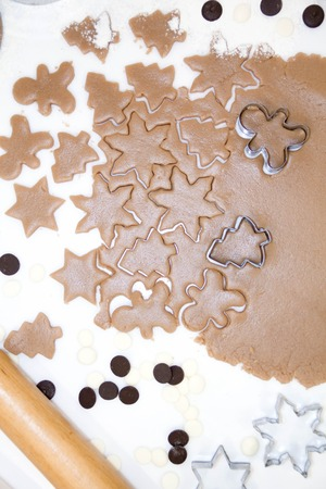 motivos navideños: Christmas cookies. Baking Roll out the bake to cut stars on a wooden background Foto de archivo