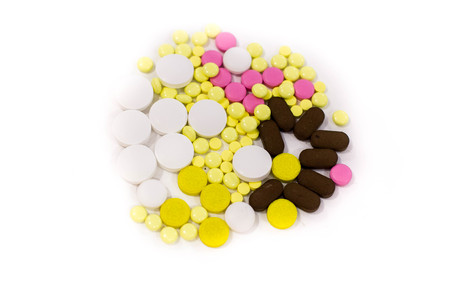 Pharmacy theme. Multicolored Isolated Pills. Capsules on the White Surface. Closeup