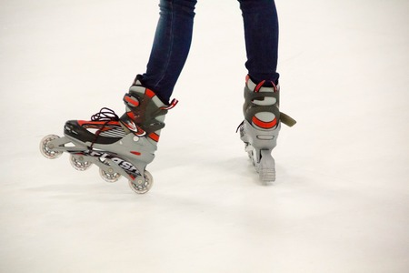 roller blade: Close up view, on white, of inline skate