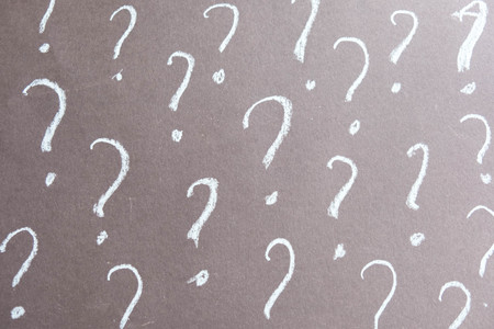 Question marks written on blackboard. Problems to solve concept