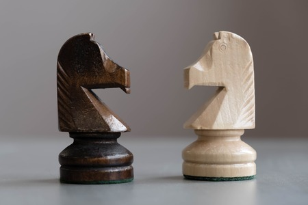 International Day of Chess, figures. Chess photographed on a chessboard. Chess is an strategy and intelligence board game originated in India that is played between two people on a chessboard. Stock Photo