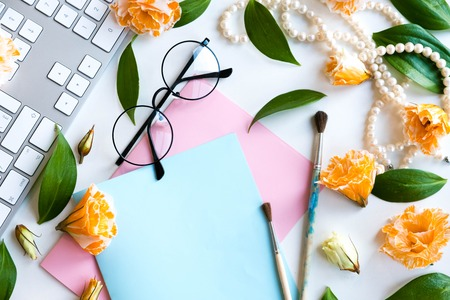 Flat lay, top view office table desk. Notes of creative worker scattered on table. Work place of a creative person with a variety of colorful stationery objects