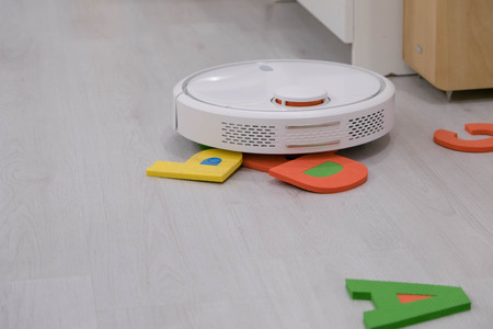 appliance: robotic vacuum cleaner stuck on a childrens toy, a difficult obstacle