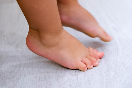 children s feet: Childrens bare feet. Childs bare feet the wooden floor