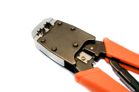 rj45 network crimper close up with red handles on white isolated background. Copy space