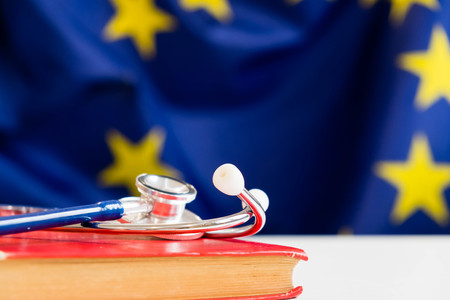 stethoscope with European Union flag. Concept of the health of Europe. Stethoscope over European Flag stethoscope with a book, education concept