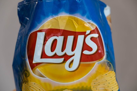 stackable: Moscow, Russia - October 8, 2017: Bag of lays sour cream and fried potatoes with onions potatoes.
