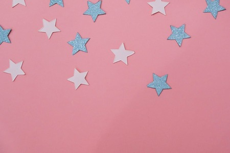 prediction: star sprinkles on pink. Festive holiday background. Celebration concept. Top view, flat lay. Horizontal Stock Photo