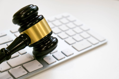 Top view, flat lay. Close up on a white background. copy space for text, selective focus. justice and law concept.Lawyer workplace with laptop and documents with dark wooden Stockfoto