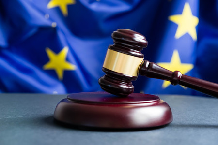 Judges wooden gavel with EU flag in the background. Symbol for jurisdiction. Wooden gavel on european union flag Фото со стока - 88328995