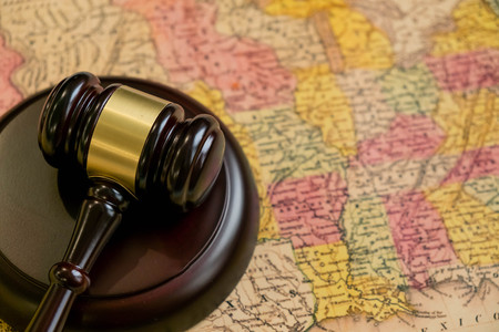 Judges wooden gavel and USA map. concept of the judicial system in many States, attorneys fees in different States, justice in the American