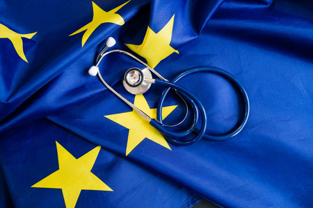 stethoscope with European Union flag. Concept of the health of Europe. Stethoscope over European Flag