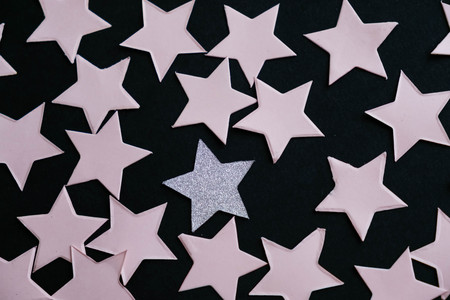 Individuality concept stars on black background.