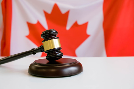 Gavel and Flag of Canada Stock Photo