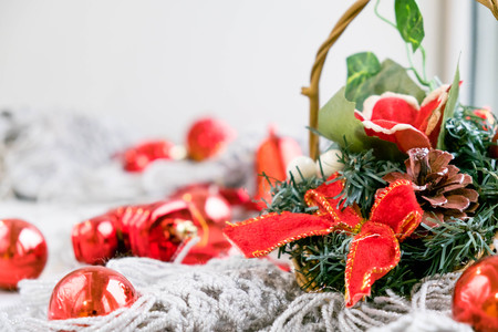 Red Christmas decoration with glass balls, fir branch and candle