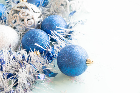 stock photo white christmas ornaments on light blue background with colorful bokeh lights merry christmas card winter holiday xmas theme - Light Blue And White Christmas Decorations
