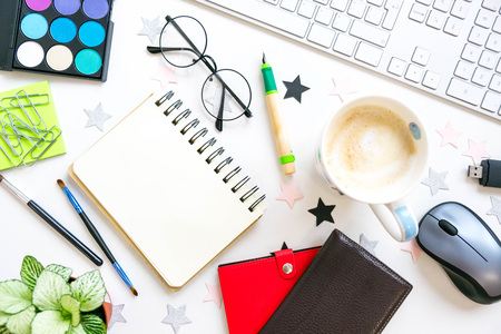 Stylish office table desk. Workspace with laptop, diary, succulent on white background. Flat lay, top view. trendy office 写真素材