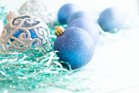 stock photo white christmas ornaments on light blue background with colorful bokeh lights merry christmas card winter holiday xmas theme - Light Blue Christmas Ornaments