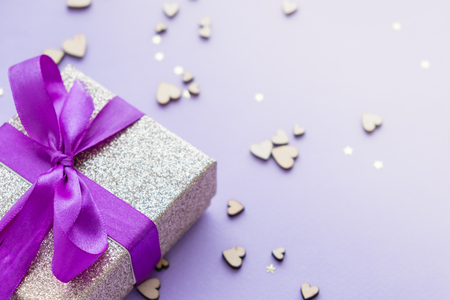 gift box on a violet background. Space for text, top view. Writing romantic letters. Stock Photo