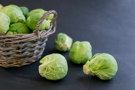 fresh raw brussels sprouts on a wooden table. Top view with copy space. Dark background. table Reklamní fotografie