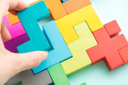 Puzzle on wooden boards team business concept Foto de archivo