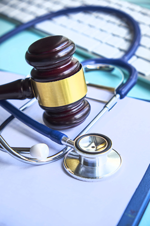 Gavel and stethoscope. medical jurisprudence. legal definition of medical malpractice. attorney. common errors doctors, nurses and hospitals