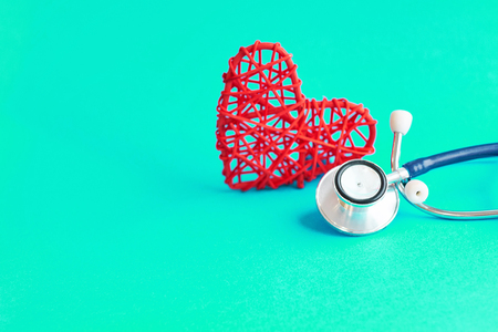 stethoscope and red heart on blue background, medical care concept, staff medical insurance Stok Fotoğraf