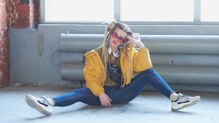 portrait of an eccentric modern young woman, bright make-up sunglasses, and a crazy hairstyle. м