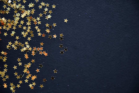 Golden Christmas stars on black background. 版權商用圖片