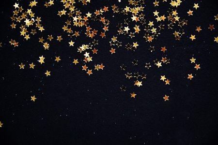 Golden Christmas stars on black background. Reklamní fotografie