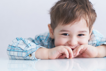 portrait of a cute little boy naughty face. stubborn kid 3 years old does not listen to mom