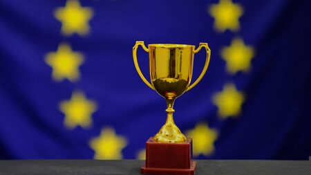 Trophy on european union flag background. Victory concept