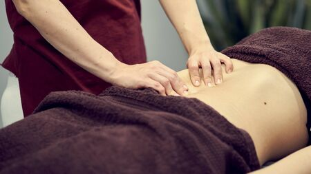 Treatment massage for weight loss in spa salon. Massage back for woman. Spa massage for correction figure