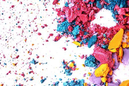 Macro texture Broken eye shadow multi-colored powder, isolated on white background. Banco de Imagens