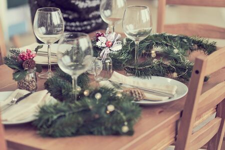 woman is waiting for guests and sets the table. festive laying table, preparation for christmas dinner