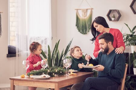 Family Together Christmas Celebration Concept. Family Enjoying christmas dinner background Zdjęcie Seryjne