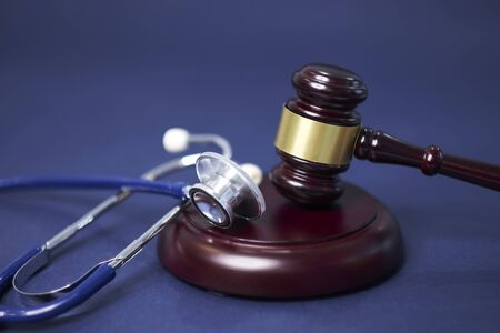 Stethoscope and judgement hammer. Gavel and stethoscope. medical jurisprudence. legal definition of medical malpractice. attorney. common errors doctors, nurses and hospitals make.