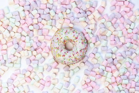 donut in a round marshmallow frame on a white background. top view photo.