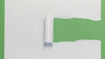 Torn Paper showing green background isolated on a white background Banque d'images
