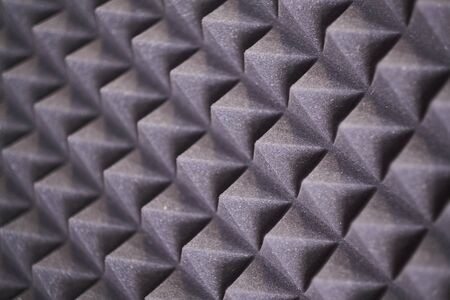The pattern of the soundproof panel of polyurethane foam. black geometric background. Banque d'images