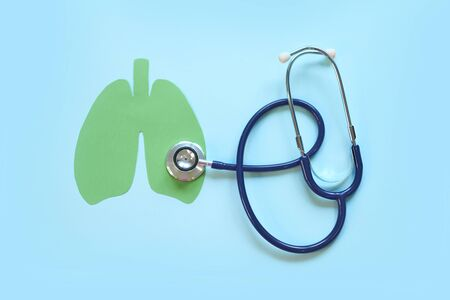 Lung health therapy medical concept . silhouette of the lungs and a stethoscope on a green background. concept of respiratory disease, pneumonia, tuberculosis, bronchitis, asthma