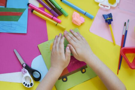 School supplies, stationery on yellow background - space for caption. Child ready to draw with pencils and make application of colored paper. Top view. 版權商用圖片