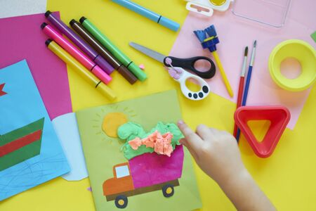School supplies, stationery on yellow background - space for caption. Child ready to draw with pencils and make application of colored paper. Top view. Zdjęcie Seryjne